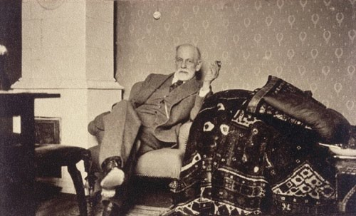 Sigmund Freud sitting at his couch