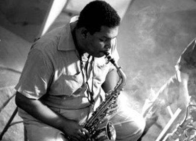 Cannonball Adderley playing alto saxophone live in a studio