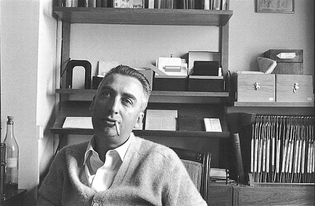 Roland Barthes sitting in his study.