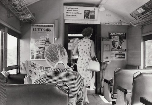 Andr Kertsz: On Reading. L.I. Train (woman reading newspaper), September 4, 1965