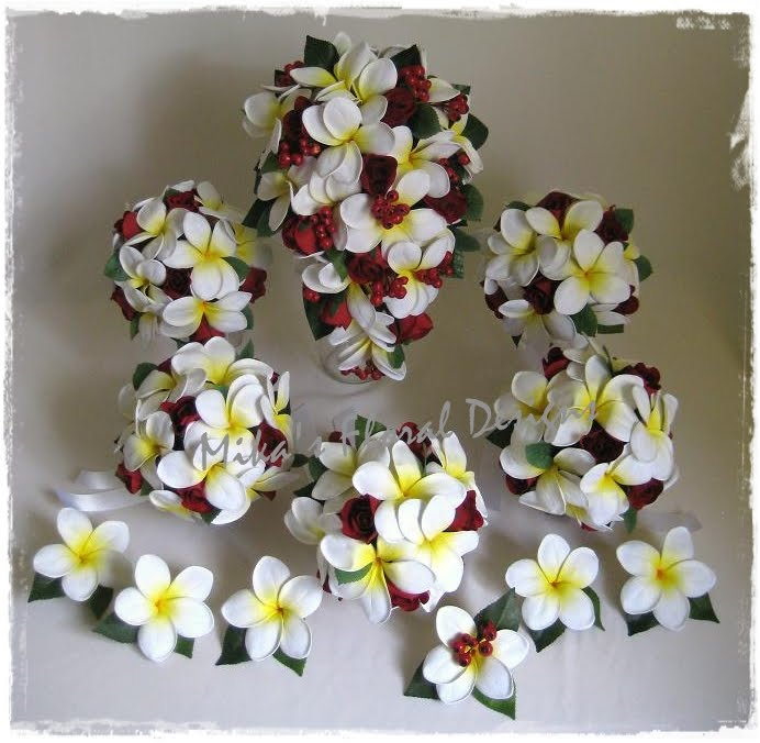 Frangipani and Rose Arrangements