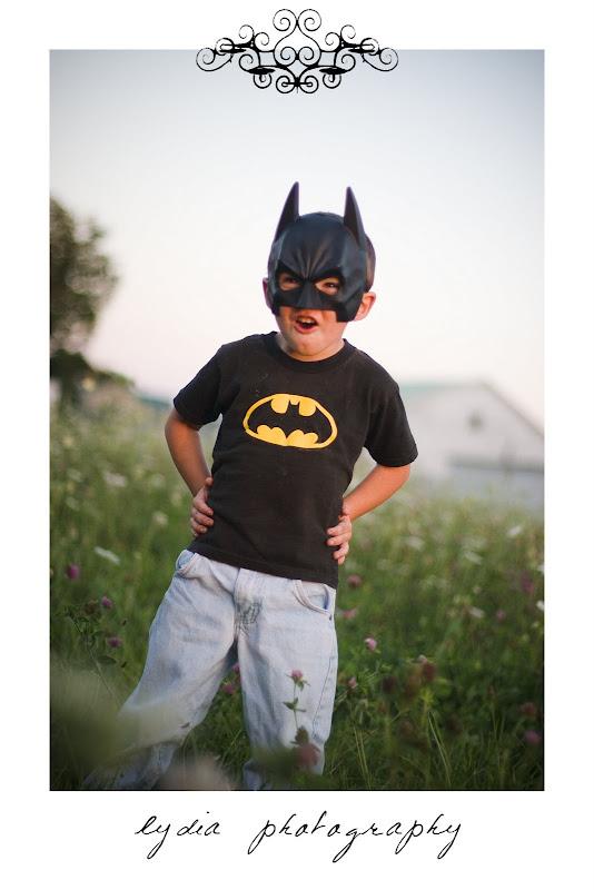 Little batman boy at lifestyle kids portraits on a farm in Indiana, Pennsylvania