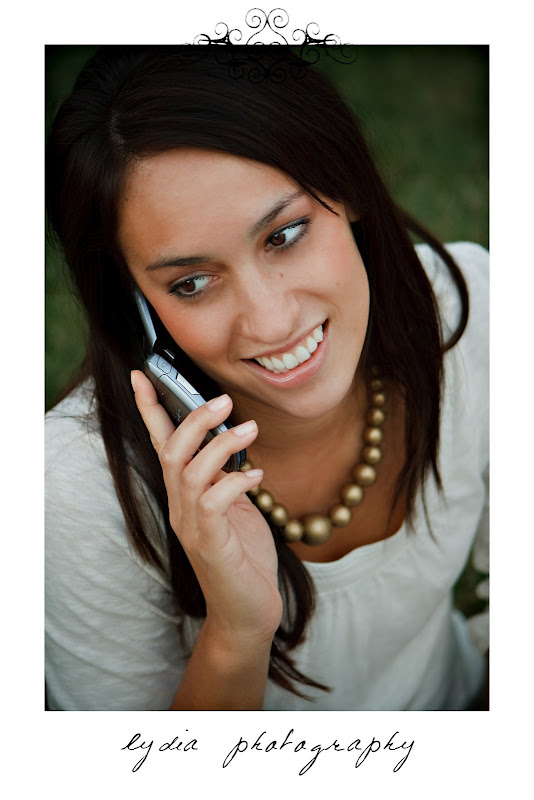 Bride holding a phone at lifestyle engagement portraits in Grass Valley, California
