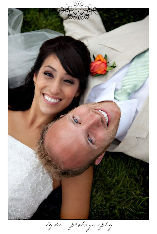 Bride and groom on each others shoulders at modern, citrus, backyard wedding at Pine Ranch in California