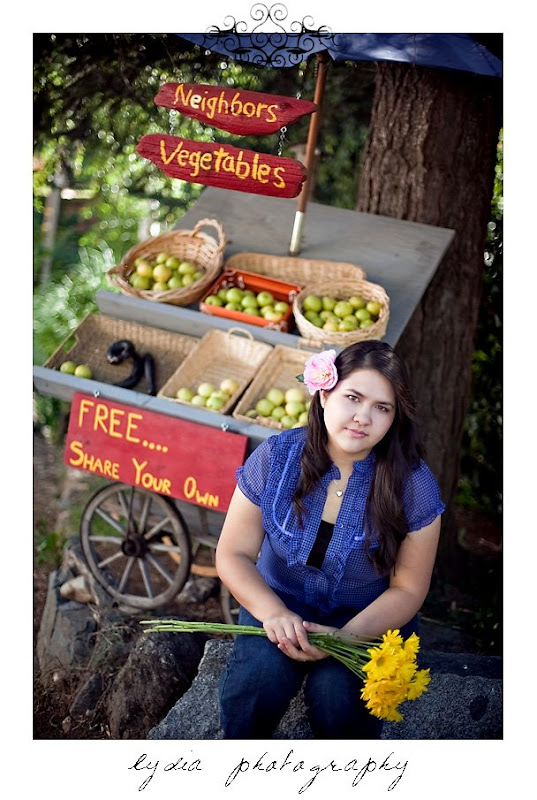 Elizabeth's senior portraits in front of a fruit stand in Nevada City
