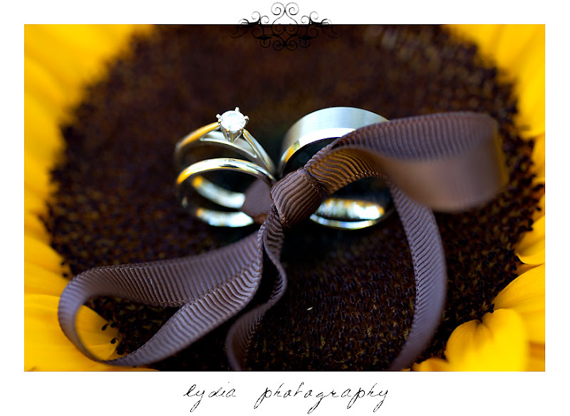The bride and groom's rings tied to a sunflower at a Kenwood Farms & Gardens wedding