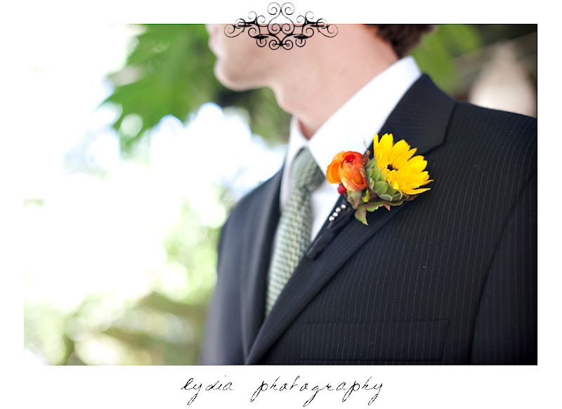 The groom's sunflower and peony boutonniere at a Kenwood Farms & Gardens wedding