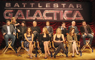 From left: Executive producer David Eick; unidentified worker; executive producer Ron Moore; actors  Grace Park (Sharon Valerii), Edward James Olmos (Adm. William Adama), Tricia Helfer (Number Six), Jamie Bamber (Capt. Lee