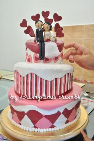 Artis Wedding Cake : Scrumptious-Crumbs: A topsy-turvy maroon wedding cake!