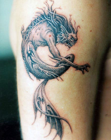 Dragon tattoos represent many different things and can be done in art,