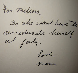 A hand written note which says: To Meliors, so she won't have to re-educate herself at 40, love mom