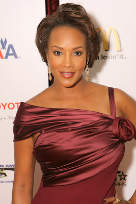 Vivica Fox Looks Sensational In This Wine With Satin Trim Christian