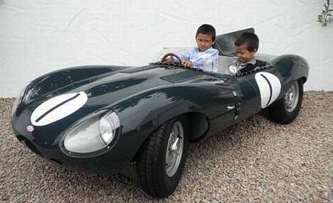 the 1955 d type jaguar childrens car is built to be an exact 23 size replica of the legendary long nose and runs on a four stroke 110cc electric start