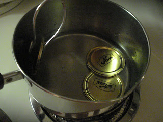 Boil lids in pan of water
