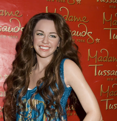 miley cyrus hair extensions. Miley Cyrus Curly Hair