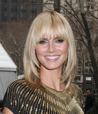 a full head of long soft blonde romantic hair with a side-swept fringe