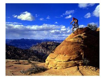 [US45_HGA0001_M~Biker-Challenges-Slickrock-near-Rockville-Utah-USA-Posters.jpg]