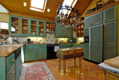 Turquoise cabinets and butcher block! Can I move in today, pretty