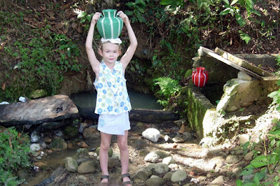 Genna Rice Carrying Water for the Family