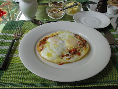 sun house hotel galle sri lanka cheese chilli and tomato fried egg on a plate
