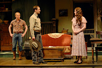 Deputy File (Anthony Fusco, center) ardently woos a newly empowered Lizzie Curry (René Augesen) as her younger brother Jim (Alex Morf, left) watches hopefully in A.C.T.'s production of N. Richard Nash's The Rainmaker.