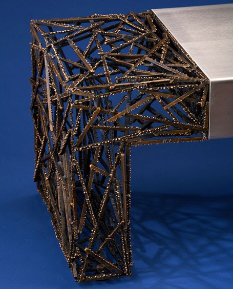 ... Polyester Resin And A Dash Of Aerospace Engineering, Lee J. Rowland  Created The Ripple Series, Tables That Appear To Stop Time In Its Rippling  Tracks.