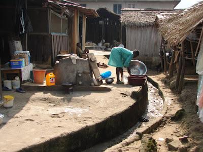 open sewer in elubo ghana market