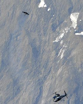 Man Flies Like A Bird Over The Alps With Jet-Propelled Wings (3) 3