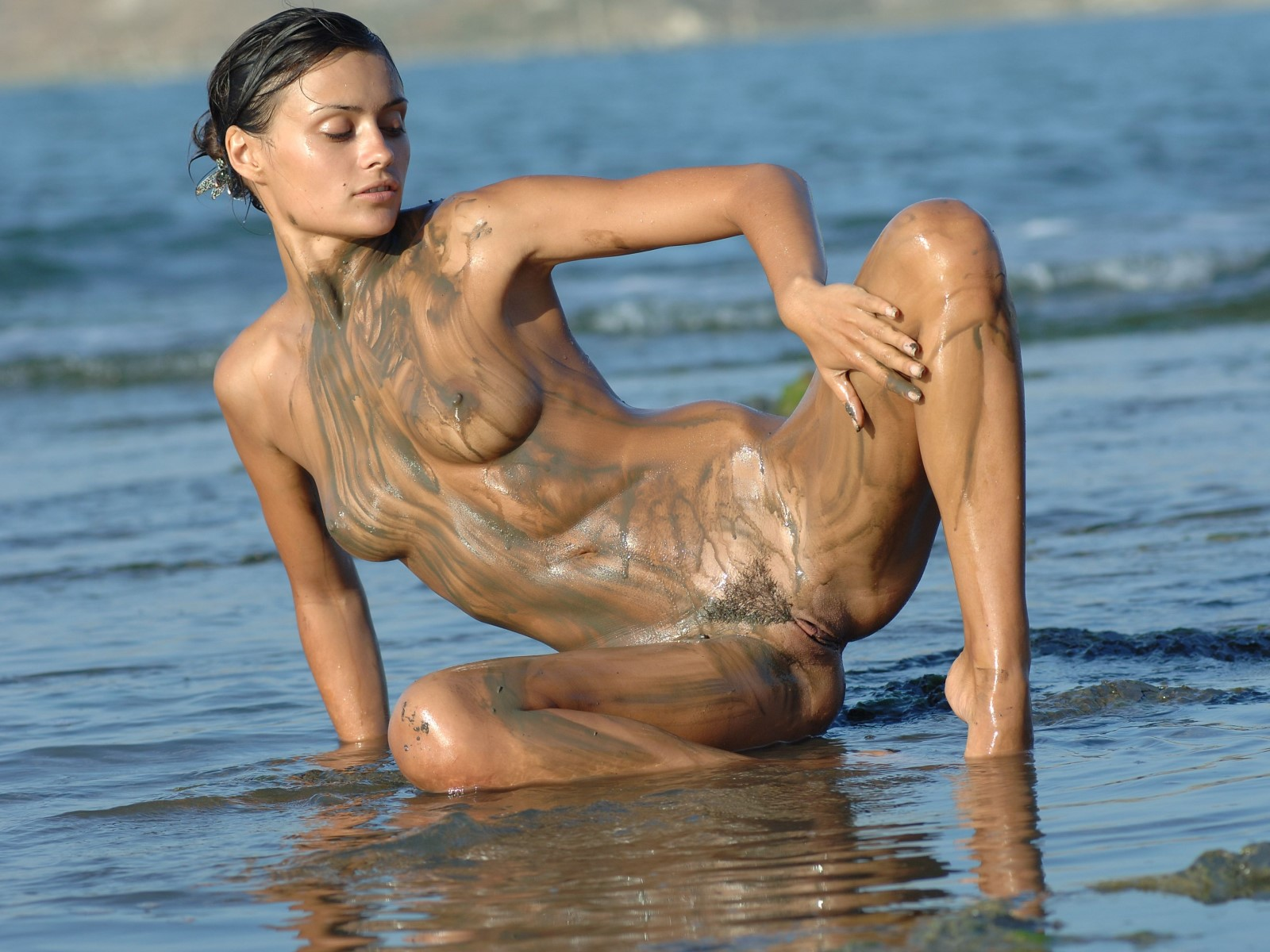 Nude Babe Playing With Mud