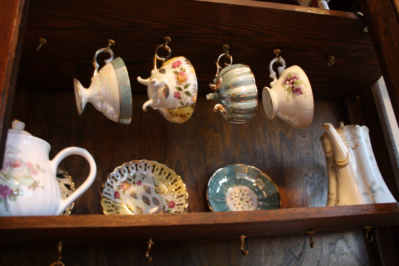 I Was Pleased To Find Out That Three Of The Shelves Had Hooks For Hanging  Teacups. I Immediately Took Out My Favorites And Hung Them Up.