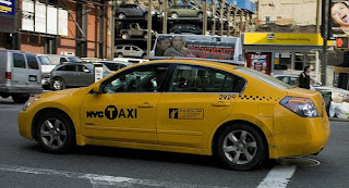 hybrid altima taxi cab in NYC