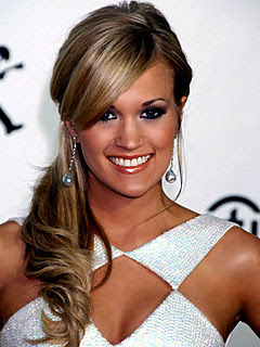 Carrie Underwood in a long hairstyle with bangs