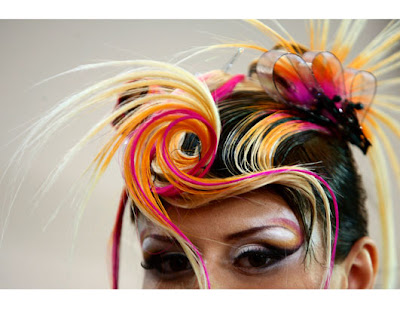 Models display hair creations during the Europe Cup open 2009 competition in
