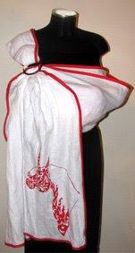 Ένα πολύ ιδιαίτερο sling από εξαιρετικό λινό, για μια πιο ξεχωριστή εμφάνιση, σε βάφτιση ή καλοκαιρινό γάμο