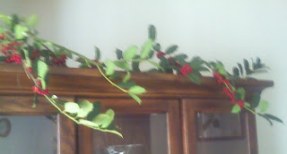 holly branches over china cabinet