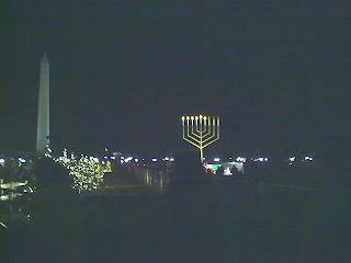 Giant menorah with Washington Monument in background
