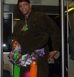 guy on subway selling trinkets that light up