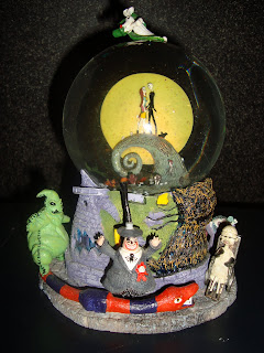 there is an automatic blower music box and jack swivels in his snowmobile chair with a working headlight plays this is halloween and features 17 - Nightmare Before Christmas Music Box