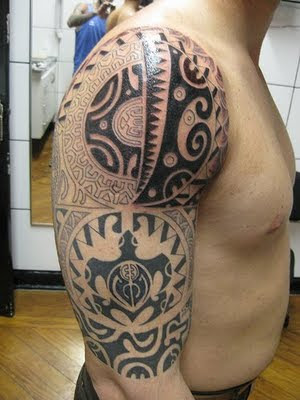 Big tribal tattoo on man strong