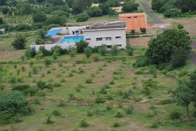 Sainik School Bijapur-swimming pool surrounded by green plantations