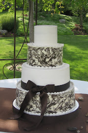4-tier round buttercream and marbled chocolate