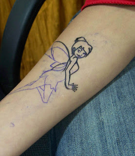 My Tinkerbell tattoo done in 06' Another tattoo design which is very popular
