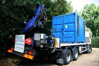 Power Electrics lorry delivering the large generator within a container to the compound at Basildon Park
