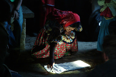 Woman examines woven portable light mat - Photo: Stanford Richins 