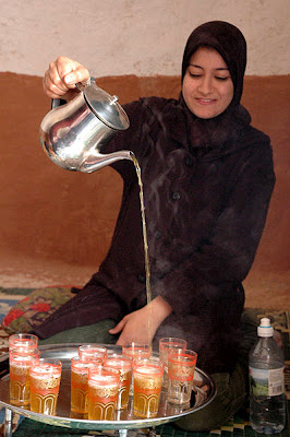 Traditional method of pouring green mint tea