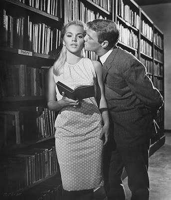 Tuesday Weld tries to read despite distractions.