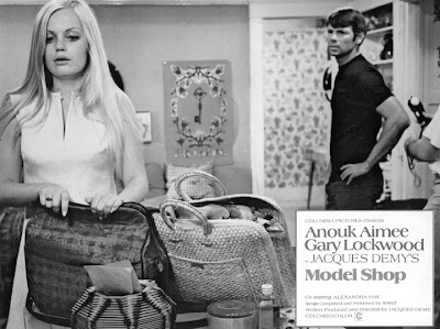 Alexandra Hay and Gary Lockwood in a non-automotive scene. She's packing to leave him.