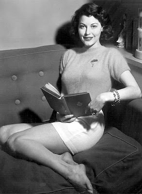 Ava Gardner enjoys a good book. And I enjoy a good Ava Gardner photo.