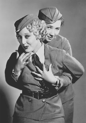 Patsy Kelly gets chummy with Thelma Todd.