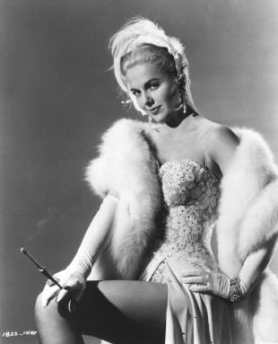 Martha Hyer smiles knowingly about the pleasures of nicotine.